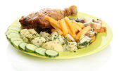 Roast chicken with potatoes, and cucumbers on plate, isolated on white — Stock Photo