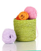 Colorful yarn for knitting in green basket isolated on white — Foto de Stock