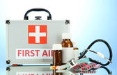 First aid box, on blue background — Stock Photo