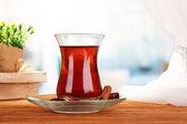 Glass of Turkish tea, on wooden table — Stock Photo