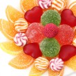 Colorful jelly candies on plate isolated on white — Stock Photo #14670417