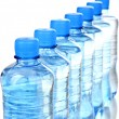 Stock Photo: Plastic bottles of water isolated on white