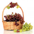 Delicious ripe pink and green grapes in basket isolated on white — Stock Photo #14670811