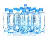 Plastic flessen water geïsoleerd op wit — Stockfoto