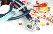 Medicines and a stethoscope on a blue background close-up — Foto de Stock