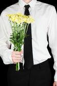 Man holding flowers close-up — Stock Photo