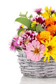 Beautiful bouquet of bright flowers in basket isolated on white — Stock Photo