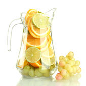Transparent jar with citrus fruits and grape, isolated on white — Stock Photo