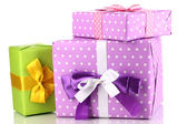 Colorful purple and green gifts isolated on white — Stok fotoğraf