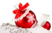 Beautiful bright Christmas balls on snow, isolated on white — Stock Photo