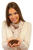 Beautiful young woman with coffee beans, isolated on white — Stock Photo