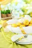Beautiful holiday table setting with lemons, close up — Stock Photo