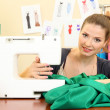 Beautiful young dressmaker in workroom — Stock Photo #14737585
