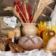 Different types of rye bread on wooden table on autumn composition background — Stock Photo