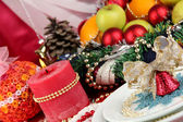 Small Christmas bell on a plate on serving Christmas table background close-up — Stock Photo