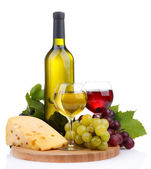 Bottle and glasses of wine, assortment of grapes and cheese isolated on white — Stock Photo