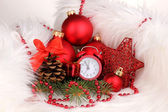 Christmas decoration with clock in white fur — Stock Photo