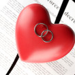 Red heart with torn Divorce decree document, on black background close-up — Stock Photo