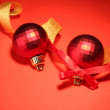 Stock Photo: Beautiful bright Christmas balls on red background