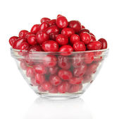 Fresh cornel berries in glass bowl isolated on white — Stock Photo