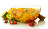 Punch in glass bowl with fruits, isolated on white — Stock Photo