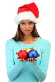 Beautiful young woman with christmas balls, isolated on white — Stock Photo