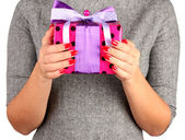 Woman holds box with gift on white background close-up — Stock Photo