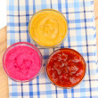 Various sauces on chopping board close-up - Stock fotografie