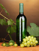 Bottle of great wine on wooden table on brown background — Stockfoto