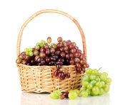 Delicious ripe pink and green grapes in basket isolated on white — Stock Photo