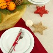 Beautiful christmas table setting with tangerines and fir tree, close up - 