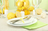 Beautiful holiday table setting with lemons, close up — Stok fotoğraf