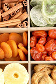 Dried fruits and cinnamon in box close-up — Stock Photo