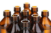 Medical bottles in the row isolated on white — Stock Photo