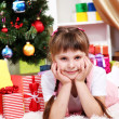 Little girl near the Christmas tree in festively decorated room — Stock Photo