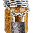 Secret ingredient with chain and padlock isolated on white - Stock Photo