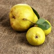 Juicy flavorful pears on sackcloth — Stock Photo #14944773