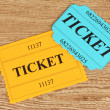 Colorful tickets on wooden background close-up — Zdjęcie stockowe