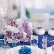 Stock Photo: Serving fabulous wedding table in purple and blue color of the restaurant background