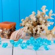 Stock Photo: Decor of seashells on wooden table on blue wooden background