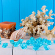 Decor of seashells on wooden table on blue wooden background — Stock Photo #14945691