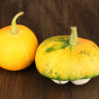 Stock Photo: Two pumpkins on wooden background