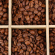 Coffee beans in wooden box close-up — Stock Photo #14946841