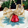 Royalty-Free Stock Photo: Small Christmas bell on a plate on serving Christmas table background close-up