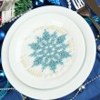 Serving Christmas table in blue tone close-up - Stock Photo