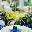 Serving Christmas table in blue tone on window background - Stock Photo