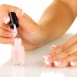Woman makes herself a French manicure, on white background — Stock Photo