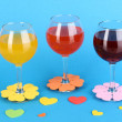 Colorful cocktails with bright decor for glasses on blue background - Stock Photo