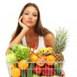 Beautiful young woman with fruits and vegetables in shopping basket, isolated on white — Stock Photo