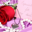 Stockfoto: Heart pendant with red rose